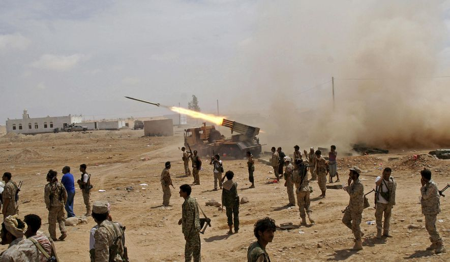 Yemeni army soldiers fire rockets at mountainous positions of al-Qaida militants at the town of Meyfaa in the southern province of Shabwa, Yemen in May 2014 file photo provided by Yemen's Defense Ministry. Al-Qaida took over multiple towns in Shabwa in 2015 and held them until they withdrew in late 2017 and early 2018. The AP found that they pulled out under secret deals with the U.S.-backed coalition that allowed them to take weapons and cash with them, integrated some of its fighters into coalition-backed forces and even paid off some militants. (AP Photo/Yemen's Defense Ministry, File)