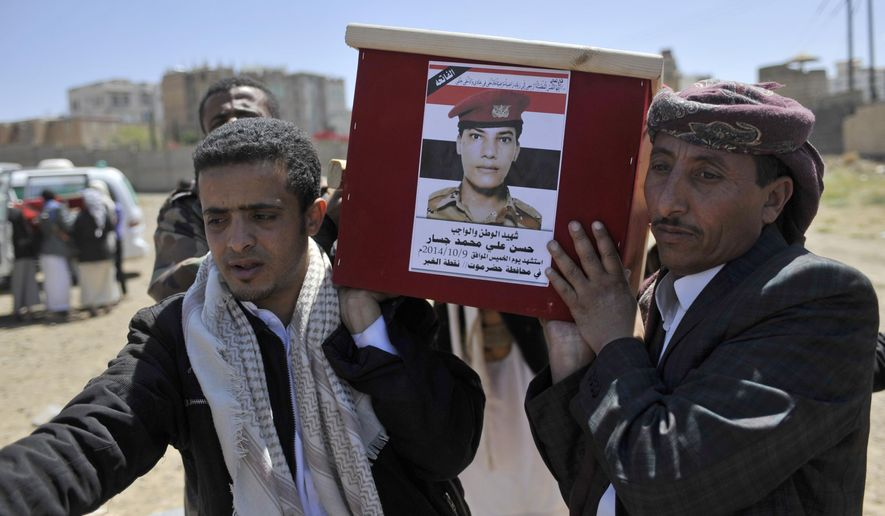 FILE - In this Oct. 13, 2014, file photo, Yemeni mourners carry the coffin of a soldier who was killed in a suicide bombing near the Yemeni port city of Mukalla. Al-Qaida militants took control of the city in 2015 and ruled it for a year until its fighters withdrew under a secret deal with the U.S.-backed coalition. It was one of a series of such deals that led to the militants abandoning several strongholds, while keeping their weapons and cash and in at least one case, receiving payments. (AP Photo/Hani Mohammed, File)