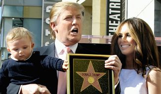 Then-reality TV star Donald Trump, wife Melania and baby son Barron pose after he received a star on the Hollywood Walk of Fame in 2007. (Associated Press)