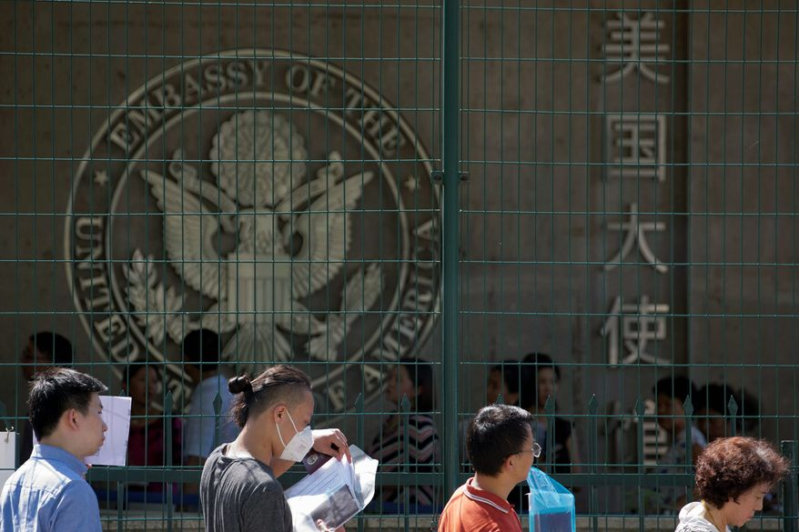 In this July 26, 2018, file photo visa applicants wait to enter the U.S. Embassy in Beijing, China. Data analysis by the Center for Migration Studies shows that about 5.5 million illegal immigrants since the year 2000 came to the U.S. legally but overstayed their visas. (AP Photo/Ng Han Guan, File) (Associated Press)