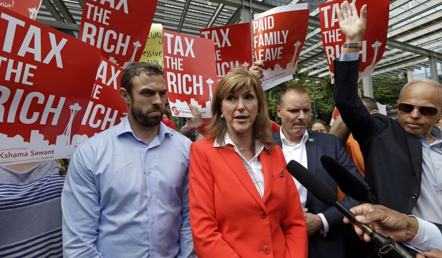 Washington State Republican Party chairman Susan Hutchison, center, speaks with media members against a new city income tax on the wealthy that was approved earlier at a Seattle City Council meeting as demonstrators holding signs in favor protest behind Monday, July 10, 2017, in Seattle. Seattle's wealthiest will become the only Washington state residents to pay an income tax under legislation unanimously approved by the City Council, a measure designed as much to raise revenue as to open a broader discussion about whether the wealthy pay their fair share. (AP Photo/Elaine Thompson)