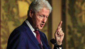 Former President Bill Clinton speaks at a symposium in Georgetown University in Washington, Monday, Nov. 6, 2017. (AP Photo/Manuel Balce Ceneta)
