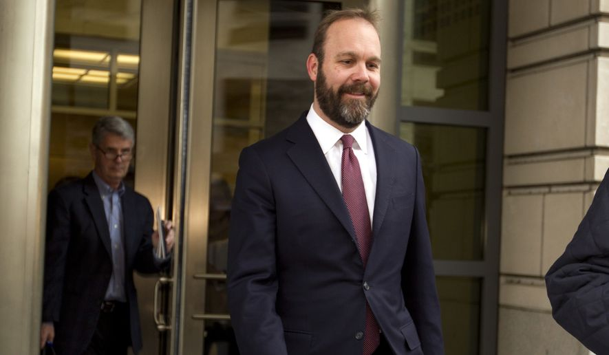 Rick Gates leaves federal court in Washington, Friday, Feb. 23, 2018. Gates, a former top adviser to President Donald Trump's campaign pleaded guilty in the special counsel's Russia investigation to federal conspiracy and false statements charges. (AP Photo/Jose Luis Magana) ** FILE **