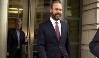 Rick Gates leaves federal court in Washington, Friday, Feb. 23, 2018. Gates, a former top adviser to President Donald Trump's campaign pleaded guilty in the special counsel's Russia investigation to federal conspiracy and false statements charges. (AP Photo/Jose Luis Magana)