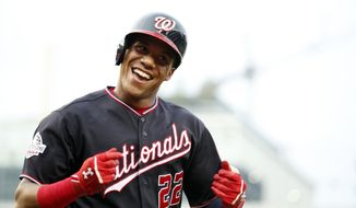 Washington Nationals' Juan Soto celebrates after his solo home run during the first inning of the second baseball game of a doubleheader against the Atlanta Braves at Nationals Park, Tuesday, Aug. 7, 2018, in Washington.(AP Photo/Alex Brandon)