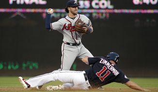 Atlanta Braves shortstop Dansby Swanson gets the out on Washington Nationals' Ryan Zimmerman as he completes a double play on Daniel Murphy during the second inning of the second baseball game of a doubleheader at Nationals Park, Tuesday, Aug. 7, 2018, in Washington.(AP Photo/Alex Brandon) ** FILE **