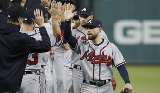 Atlanta Braves' Ender Inciarte, right, celebrates with his teammates after the second baseball game of a doubleheader against the Washington Nationals at Nationals Park, Tuesday, Aug. 7, 2018, in Washington. The Braves won 3-1. (AP Photo/Alex Brandon)