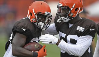 Cleveland Browns defensive back Jabrill Peppers, left, is congratulated linebacker B.J. Bello after an interception during NFL football training camp Tuesday, Aug. 7, 2018, in Berea, Ohio. (AP Photo/David Dermer)