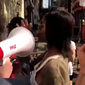 Conservative pundit Candace Owens blocks a megaphone that was in her face during a Philadelphia protest, Aug. 6, 2018. (Image: Twitter video screenshot, Candace Owens)