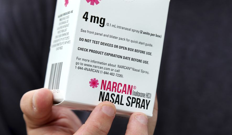 In this July 23, 2018 photo, Narcan nasal spray is shown outside a pharmacy in Greenfield, Mass. (AP Photo/Elise Amendola) ** FILE **