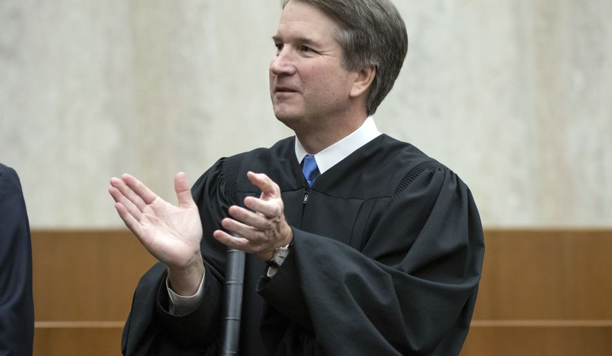 President Donald Trump's Supreme Court nominee, Judge Brett Kavanaugh, officiates at the swearing-in of Judge Britt Grant to take a seat on the U.S. Court of Appeals for the Eleventh Circuit, Tuesday, Aug. 7, 2018, at the U.S. District Courthouse in Washington. (AP Photo/J. Scott Applewhite)
