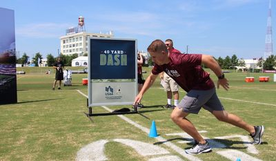 """A soldier runs the 40-yard dash at the """"USAA's Salute to Service NFL Boot Camp"""" at Bon Secours Washington Redskins Training Center in Richmond, Virginia on Tuesday, August 7, 2018. (Photo courtesy of USAA)"""