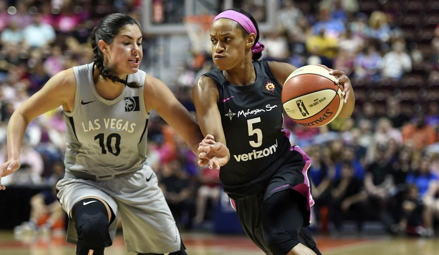 Connecticut Sun guard Jasmine Thomas (5) drives past Las Vegas Aces guard Kelsey Plum (10) in the first half half of WNBA basketball game action Sunday, Aug. 5, 2018, in Uncasville, Conn. (Sean D. Elliot/The Day via AP) **FILE**