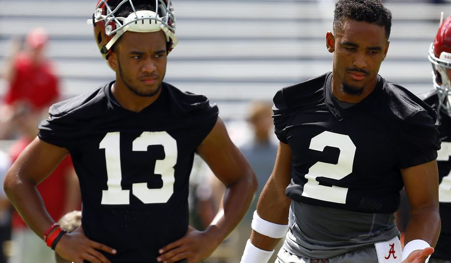 Alabama quarterback Jalen Hurts (2) and quarterback Tua Tagovailoa (13) runs drills during a NCAA college football practice, Saturday, Aug. 4, 2018, in Tuscaloosa, Ala. (AP Photo/Butch Dill)