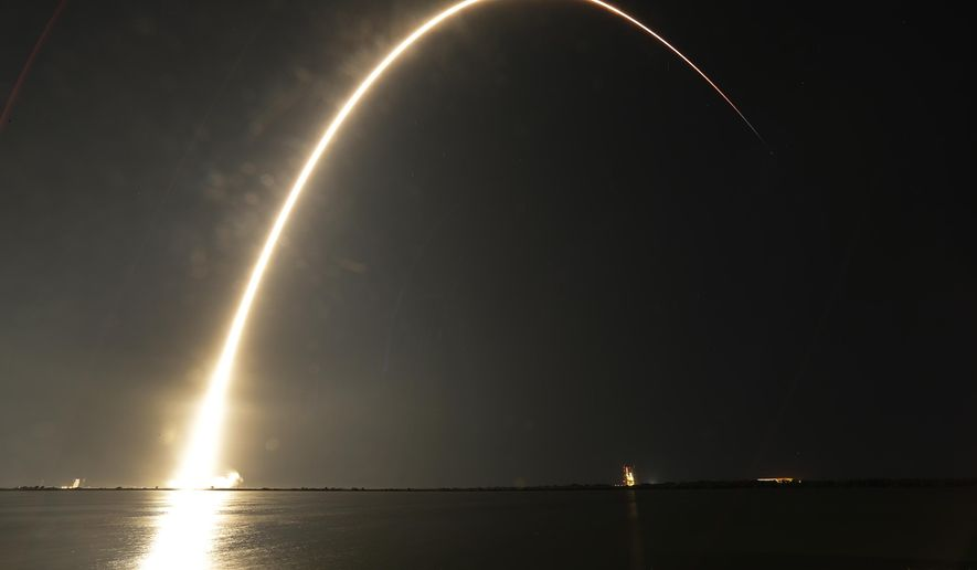 A Falcon 9 SpaceX rocket lifts off from the Cape Canaveral Air Force Station Complex 40 launch pad as seen through a time exposure in Cape Canaveral, Fla., Tuesday, Aug. 7, 2018. The payload, named Merah Putih, is a geostationary commercial communications satellite. (AP Photo/John Raoux)