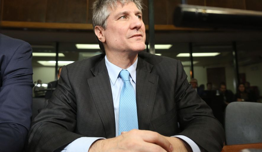 Former Argentine Vice President Amado Boudou sits in a courtroom during the verdict of the trial against him in Buenos Aires, Argentina, Tuesday, Aug. 7, 2018. Boudou was sentenced to five years and 10 months in prison for bribery and conducting business incompatible with public office. (AP Photo/Sebastian Pani)
