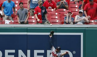 Atlanta Braves center fielder Ender Inciarte can't catch a ball hit by Washington Nationals' Juan Soto, but left fielder Adam Duvall made the catch before the ball hit the ground during the third inning of the first baseball game of a doubleheader at Nationals Park, Tuesday, Aug. 7, 2018, in Washington. (AP Photo/Alex Brandon)