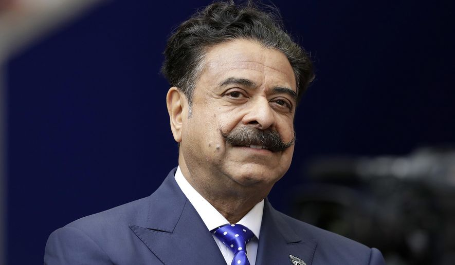FILE - In this file photo dated Sunday Sept. 24, 2017, USA Jacksonville Jaguars owner Shahid Khan before an NFL football game against the Baltimore Ravens at Wembley Stadium in London.  Fulham has returned to the English Premier League for the 2018 - 19 season, with its intimate stadium located on the banks of the River Thames in London and its owner Shahid Khan, a larger-than-life American who recently placed an offer to buy Wembley Stadium. (AP Photo/Matt Dunham, FILE)
