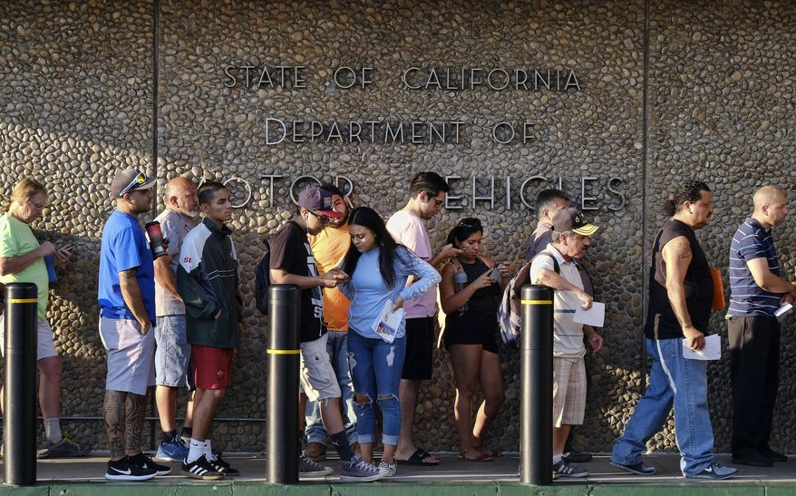 People line up at the California Department of Motor Vehicles prior to opening in the Van Nuys section of Los Angeles on Tuesday, Aug. 7, 2018. California lawmakers are seeking answers from the Department of Motor Vehicles about hours-long wait times that have prompted public outcry. Assemblyman Phil Ting will lead a hearing Tuesday afternoon to question DMV officials about what they are doing to reduce wait times amid reports that many Californians have to wait hours to renew their licenses. (AP Photo/Richard Vogel)
