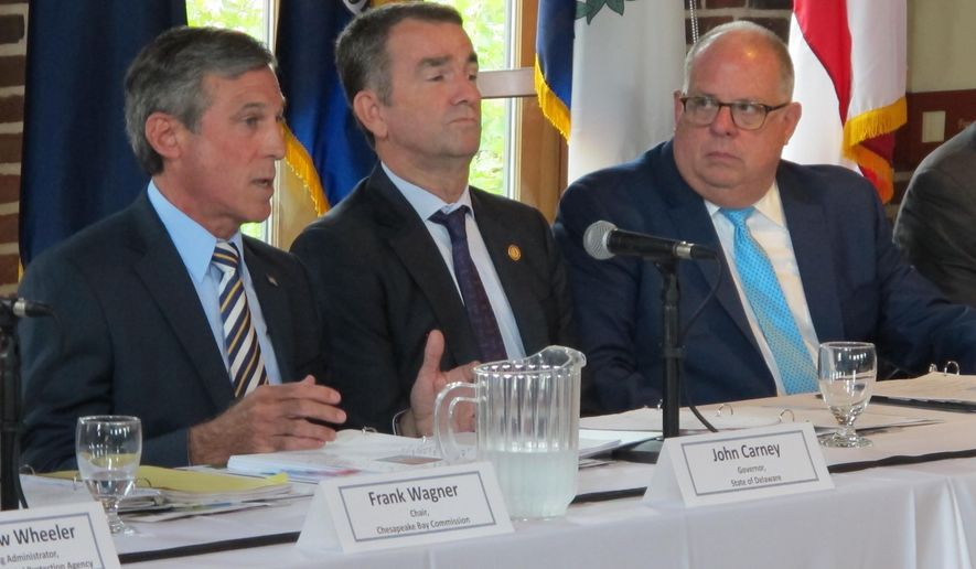 Delaware Gov. John Carney, left, speaks at a meeting of the Chesapeake Executive Council on Tuesday, Aug. 7, 2018. Virginia Gov. Ralph Northam is center and Maryland Gov. Larry Hogan is on the right.  (AP Photo/Brian Witte)