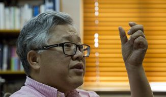 In this photo taken Wednesday, Aug. 1, 2018. pastor Jin Minri speaks during an interview at the Zion Church in Beijing, China. After Jin refused local authorities' request to install surveillance cameras inside his house church, police individually questioned hundreds of members of the 1,500-person congregation, he said. (AP Photo/Ng Han Guan)