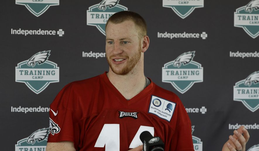 Philadelphia Eagles quarterback Carson Wentz speaks with members of the media during NFL football training camp Tuesday, Aug. 7, 2018, in Philadelphia. (AP Photo/Matt Rourke)