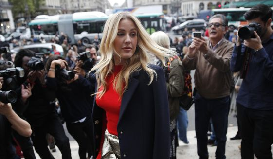 In this file photo dated Monday, Oct. 2, 2017, British singer Ellie Goulding arrives at Stella McCartney's Spring-Summer 2018 ready to wear fashion collection in Paris.  (AP Photo/Christophe Ena, FILE)