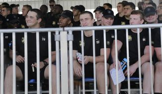 Members of the Army football team watch the New York Giants practice at the NFL football team's training camp in East Rutherford, N.J., Tuesday, Aug. 7, 2018. (AP Photo/Seth Wenig)