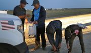 Four Guatemalan nationals consisting of two men and a pair of 12- and 13-year-old boys, remove their shoe laces and personal itmes after being arrested by a U.S. Customs and Border Patrol agent Wednesday, July 18, 2018 in Yuma, Ariz. Thousands of families and unaccompanied children are continuing to cross the U.S. border in Arizona and California even after learning of the government's family separation policy upon apprehension. (AP Photo/Matt York) **FILE**