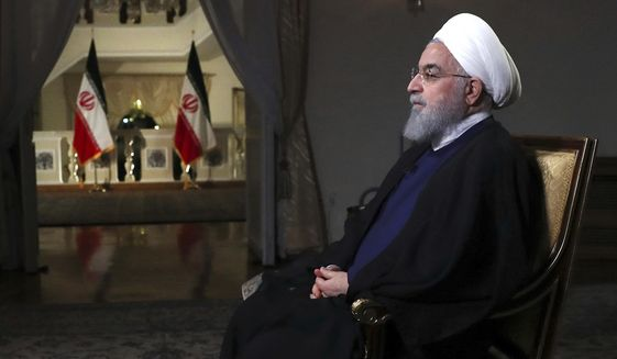 In this photo released by official website of the office of the Iranian Presidency, President Hassan Rouhani addresses the nation in a televised speech in Tehran on Aug. 6, 2018. Iranian President Hassan Rouhani struck a hard line Monday as the U.S. restored some sanctions that had been lifted under the 2015 nuclear deal. (Iranian Presidency Office via AP) **FILE**