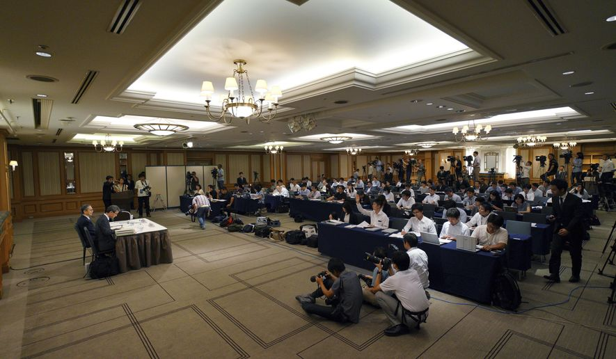 Internal investigation committee members hold a press conference on an investigation on fraud into its admissions process of Tokyo Medical University in Tokyo Tuesday, Aug. 7, 2018. Tokyo Medical University confirmed after the internal investigation that it systematically altered entrance exam scores for years to keep out female applicants and ensure more men became doctors. The manipulated all entrance tests results since 2000 or even earlier. (AP Photo/Eugene Hoshiko)