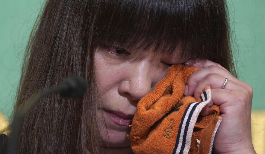 Myu, the wife of missing Japanese freelance journalist Jumpei Yasuda, wipes her tears during a press conference at Japan National Press Club in Tokyo Tuesday, Aug. 7, 2018. Myu told a news conference in Tokyo Tuesday that her husband is no enemy of the Middle East and loves its people. A video released last week showed a captive who the Japanese government said it believes is missing journalist Jumpei Yasuda. (AP Photo/Eugene Hoshiko)
