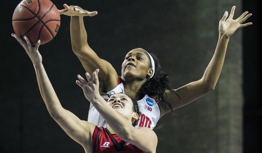 FILE - In this March 17, 2017, file photo, then-Ohio State's Tori McCoy, top, defends as Western Kentucky guard Kendall Noble (12) shoots during a first round game of the NCAA college women's basketball tournament, in Lexington, Ky. Tori McCoy hates having to watch Marquette practice from the sideline. For now, the Ohio State transfer must concentrate on her health. The junior forward needs a kidney transplant after being diagnosed with a rare disease. (Austin Anthony/Daily News via AP, File)