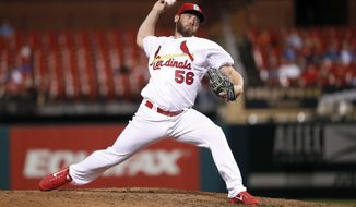 FILE- In this June 26, 2018, file photo, St. Louis Cardinals relief pitcher Greg Holland throws during the eighth inning of a baseball game against the Cleveland Indians in St. Louis. The Washington Nationals have signed the free agent reliever Greg Holland, whom they hope can regain his effectiveness and provide leadership in the clubhouse. Holland was 0-2 with a 7.92 ERA in 32 games with St. Louis before being designated for assignment on July 27. (AP Photo/Jeff Roberson, File)