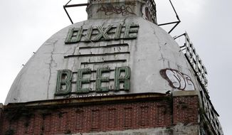 This Wednesday, July 3, 2013 file photo shows the top of the abandoned Dixie Beer brewery on Tulane Avenue in New Orleans. The company announced on Nov. 4, 2020, that it was going to soon go by the new name Faubourg Brewing Company, retiring the old Dixie name out of concerns it was racially insensitive. (AP Photo/Gerald Herbert)