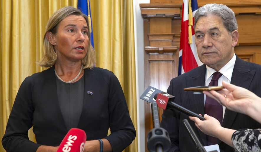 European Union foreign policy chief Federica Mogherini, left, and New Zealand Foreign Minister Winston Peters address a press conference after their meeting at Parliament in Wellington, New Zealand, Tuesday, Aug. 7, 2018. Mogherini said the EU is encouraging enterprises to increase their business with Iran, as that country has been compliant with their nuclear-related commitments. (Mark Mitchell/New Zealand Herald via AP)