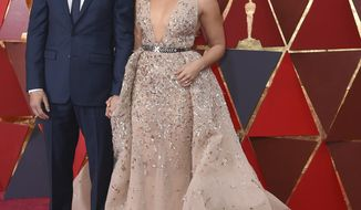 """FILE - In this March 4, 2018 file photo, Joe LoCicero, left, and actress Gina Rodriguez arrive at the Oscars in Los Angeles. The couple, who are engaged, met when he was a guest star on """"Jane the Virgin."""" (Photo by Richard Shotwell/Invision/AP, File)"""