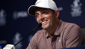 Francesco Molinari, of Italy, smiles as he listens to a question during a news conference at the PGA Championship golf tournament Tuesday, Aug. 7, 2018, at Bellerive Country Club in St. Louis. (AP Photo/Jeff Roberson)
