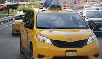 In this Wednesday, Aug. 1, 2018 photo, yellow taxis line up at LaGuardia airport in New York. Once synonymous with New York City, yellow taxis have been supplanted by an army of black cars that pick up riders through the Uber, Lyft and other apps. The rise in the number of ride-hail vehicles has been so dizzying that the New York City Council is pondering a series of legislative proposals to be voted on Wednesday, Aug. 8. (AP Photo/Frank Franklin II)