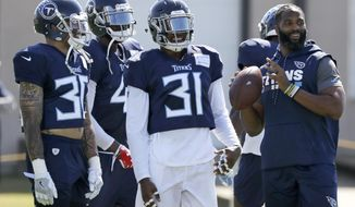 """Tennessee Titans defensive back Kevin Byard (31) waits for his turn to run a drill during NFL football training camp Tuesday, Aug. 7, 2018, in Nashville, Tenn. Byard has been called just a """"fan"""" on Twitter by Hall of Famer Deion Sanders. Well, Byard is busy working hard for a follow-up to his second season in the NFL when he tied for the league-lead with eight interceptions earning both All Pro and Pro Bowl honors. (AP Photo/Mark Humphrey)"""