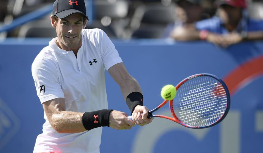 Andy Murray, of Britain, returns the ball against Kyle Edmund, of Britain, during the Citi Open tennis tournament Wednesday, Aug. 1, 2018, in Washington. (AP Photo/Nick Wass)