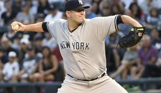 New York Yankees starting pitcher Lance Lynn (36) throws the ball against the Chicago White Sox during the first inning of a baseball game, Monday, Aug. 6, 2018, in Chicago. (AP Photo/David Banks)