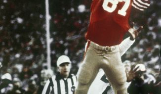 """FILE - In this Jan. 10, 1982, file photo, San Francisco 49ers' Dwight Clark leaps high in the end zone to catch a touchdown pass late in the fourth quarter of the NFC championship NFL football game against the Dallas Cowboys at Candlestick Park in San Francisco. The 49ers will honor Clark with a season-long celebration of his life that will include unveiling a statue of """"The Catch."""" Clark died in June at age 61. (Phil Huber/The Dallas Morning News via AP, File)"""