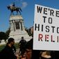 Virginia state law has prevented the city of Charlottesville from taking down the bronze statue of Robert E. Lee atop his horse Traveler, despite race-tinged clashes that left one counterprotester dead nearly one year ago. (Associated Press)
