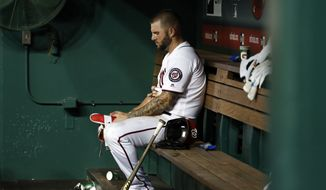 Washington Nationals' Matt Adams sits in the dugout after the Atlanta Braves' 8-3 win in a baseball game Wednesday, Aug. 8, 2018, in Washington. (AP Photo/Alex Brandon) ** FILE **