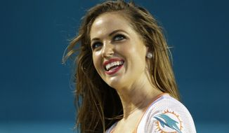 Former Miami Dolphins cheerleader Kristan Ann Ware says she was physically and verbally abused by her coach once it became known that she was a virgin and chose to wait for marriage as part of her Christian faith. (Associated Press)