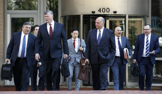 The defense team for Paul Manafort, including Kevin Downing, front left, Thomas Zehnle, front right, and Jay Nanavati, back row second from right, arrive at federal court for the continuation of the trial of the former Trump campaign chairman, in Alexandria, Va., Wednesday, Aug. 8, 2018. (AP Photo/Jacquelyn Martin)