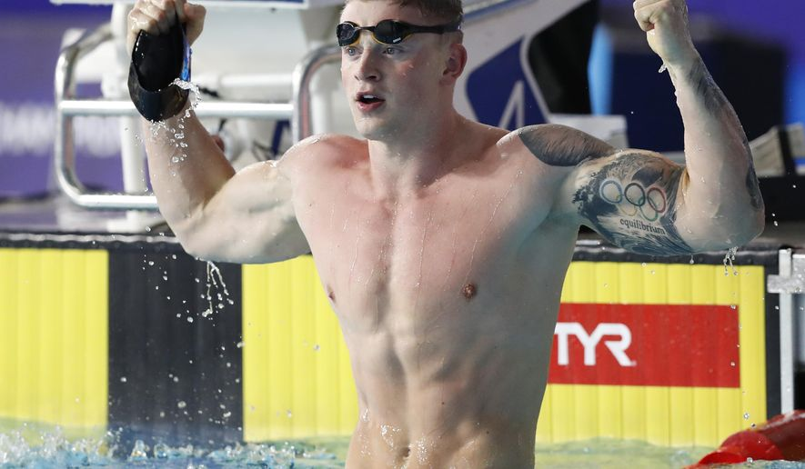 Adam Peaty of Great Britain celebrates after winning the gold medal in the 50 meter breaststroke men final at the European Swimming Championships in Glasgow, Scotland, Wednesday, Aug. 8, 2018. (AP Photo/Darko Bandic)