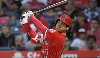 CORRECTS TO THREE-RUN, INSTEAD OF SOLO, HOME RUN  - Los Angeles Angels' Shohei Ohtani, of Japan, watches his three-run home run during the first inning of the team's baseball game against the Detroit Tigers on Tuesday, Aug. 7, 2018, in Anaheim, Calif. (AP Photo/Mark J. Terrill)