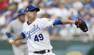 Kansas City Royals pitcher Heath Fillmyer throws to a Chicago Cubs batter during the first inning of a baseball game at Kauffman Stadium in Kansas City, Mo., Wednesday, Aug. 8, 2018. (AP Photo/Colin E. Braley)